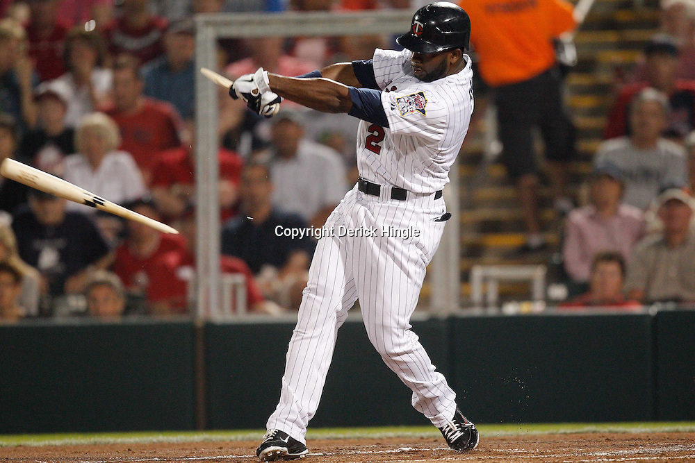 February 27, 2011; Fort Myers, FL, USA; Minnesota Twins center fielder Denard Span (2) breaks his bat during a spring training exhibition game against the Boston Red Sox at Hammond Stadium.  Mandatory Credit: Derick E. Hingle