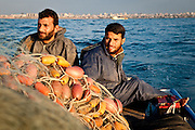 Hassan Mughdad, right, a fisherman from Beach Camp, lost a brother to an Israeli airstrike during Operation Cast Lead.