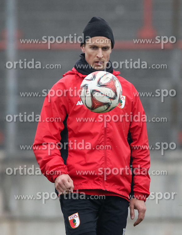 17.02.2015, Trainingsgel&auml;nde, Augsburg, GER, 1. FBL, FC Augsburg, Training, im Bild Christoph Janker (FC Augsburg #16) spielt den Ball, // during a trainingssession of the german 1st bundesliga club FC Augsburg at the Trainingsgel&auml;nde in Augsburg, Germany on 2015/02/17. EXPA Pictures &copy; 2015, PhotoCredit: EXPA/ Eibner-Pressefoto/ Krieger<br /> <br /> *****ATTENTION - OUT of GER*****