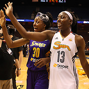 Sisters Chiney Ogwumike, (right), Connecticut Sun and Nneka Ogwumike, Los Angeles Sparks, (wearing face mask), at the end of the game after playing against each other for the fist time in the WNBA during the Connecticut Sun Vs Los Angeles Sparks WNBA regular season game at Mohegan Sun Arena, Uncasville, Connecticut, USA. 3rd July 2014. Photo Tim Clayton