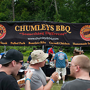 """June 9, 2012 - Vernon, NJ : Festival-goers chat and eat in front of the """"Chumleys BBQ And Catering Company"""" stand during the 3rd annual """"Rock, Ribs & Ridges"""" music and food festival in Vernon, NJ on Saturday. CREDIT: Karsten Moran for The New York Times"""