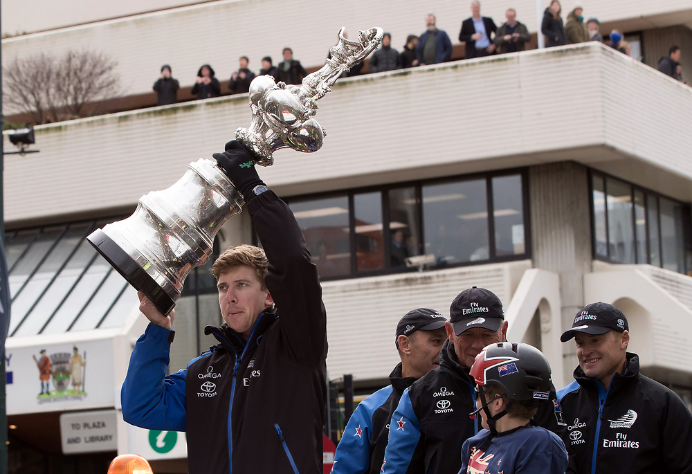 Helmsman Peter Burling, left, holds the Americas Cup aloft during Emirates Team New Zealand's victory parade in Dunedin, New Zealand, Thursday, July 13, 2017. Credit:SNPA / Adam Binns ** NO ARCHIVING**