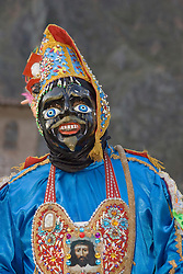 Masked dancer at Pentecostes Festival held annually in May, Ollantaytambo, Peru, South America