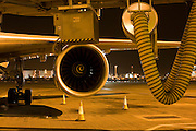Traffic cones, a Boeing engine and pre-conditioned air duct during an airliner's overnight stop at Heathrow Airport.