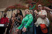 Hunts Point, Bronx, New York - Reverend Billy Talen (not pictured) leads the Church of Stop Shopping choir in a performance on the edge of the Bronx Riverr in Hunts Point, the Bronx, New York on Saturday, October 5, 2013.