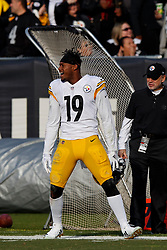 OAKLAND, CA - DECEMBER 09: Wide receiver JuJu Smith-Schuster #19 of the Pittsburgh Steelers celebrates after scoring a touchdown against the Oakland Raiders during the second quarter at the Oakland Coliseum on December 9, 2018 in Oakland, California. The Oakland Raiders defeated the Pittsburgh Steelers 24-21. (Photo by Jason O. Watson/Getty Images) *** Local Caption *** JuJu Smith-Schuster