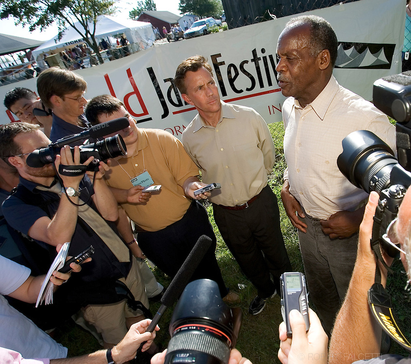 GOSHEN, CT - AUGUST 5:  Greenwich, CT businessman Ned Lamont and actor Danny Glover talk to the media outside the gate of the Litchfield Jazz Festival August 5, 2006 in Goshen, Connecticut. Lamont and his supporters including Glover and California Congreeswoman Mazine Waters were first told they would not be allowed to enter the festival by organizer Vita Muir. Muir later said they could enter and enjoy the jazz, but not campaign. Lamont is in a heated race for the Connecticut democratic nomination for Senate against Sen. Joe Lieberman. (Photo by Bob Falcetti/Getty Images)