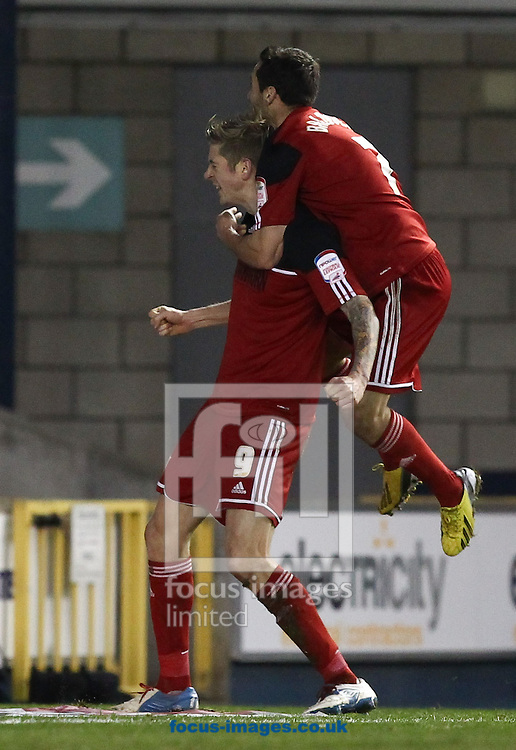 Picture by John  Rainford/Focus Images Ltd +44 7506 538356.01/01/2013.Goalscorer Jon Stead and Sam Baldock of Bristol City celebrate the equaliser against Millwall during the npower Championship match at The Den, London.