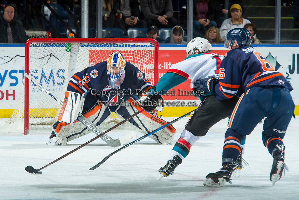 KELOWNA, CANADA - FEBRUARY 24: Kole Lind #16 of the Kelowna Rockets skates with the puck to the net of Dylan Ferguson #31 while back checked by Sean Strange #6 of the Kamloops Blazers on February 24, 2018 at Prospera Place in Kelowna, British Columbia, Canada.  (Photo by Marissa Baecker/Shoot the Breeze)  *** Local Caption ***