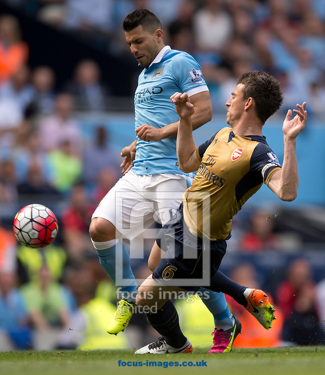 Laurent Koscielny of Arsenal (right) challenges Sergio Aguero of Manchester City during the Barclays Premier League match at the Etihad Stadium, Manchester<br /> Picture by Russell Hart/Focus Images Ltd 07791 688 420<br /> 08/05/2016