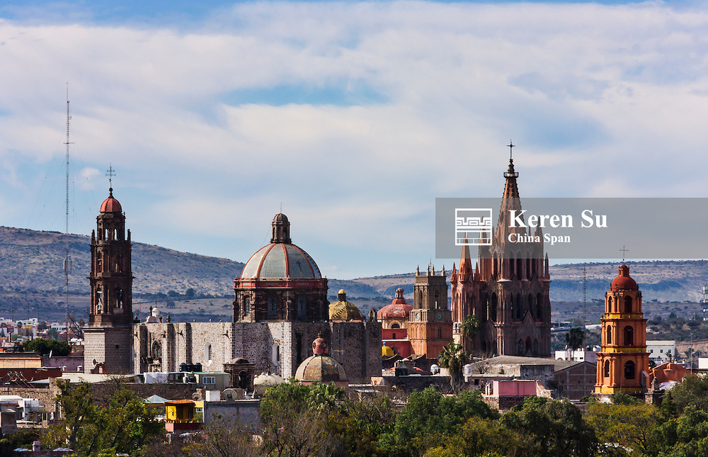Cityscape dominated by Parroquia Cathedral and other church domes, San Miguel de Allende, Mexico