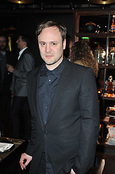 NICHOLAS KIRKWOOD at a dinner in honour of Andre Leon Talley and Manolo Blahnik held at The Spice Market restaurant at W London, Leicester Square, London on 14th March 2011.