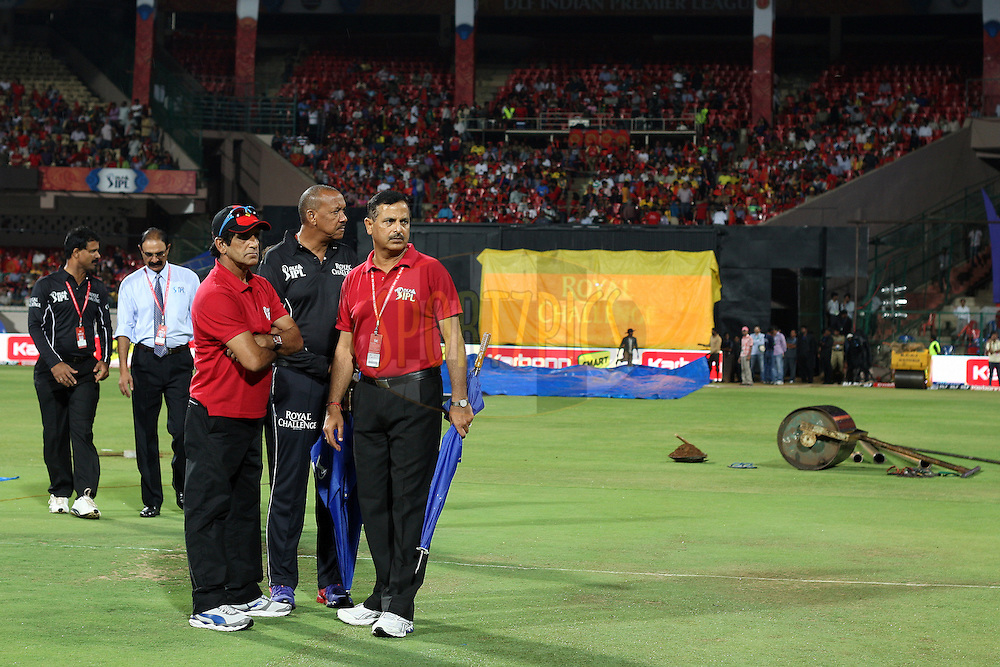 Umpires during the first inspection of the playing area after the rain stopped during match 34 of the the Indian Premier League ( IPL) 2012  between The Royal Challengers Bangalore and the Chennai Superkings held at the M. Chinnaswamy Stadium, Bengaluru on the 25th April 2012..Photo by Jacques Rossouw/IPL/SPORTZPICS