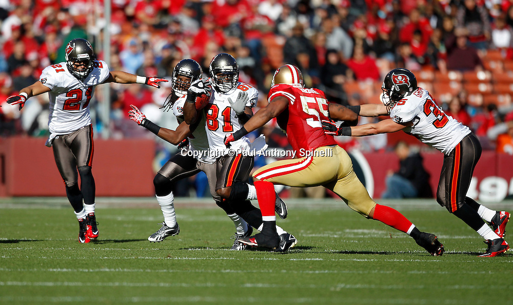 Tampa Bay Buccaneers wide receiver Micheal Spurlock (81) runs with the ball while trying to avoid a tackle attempt by San Francisco 49ers linebacker Ahmad Brooks (55) after catching a pass during the NFL week 11 football game against the San Francisco 49ers on Sunday, November 21, 2010 in San Francisco, California. The Bucs won the game 21-0. (©Paul Anthony Spinelli)
