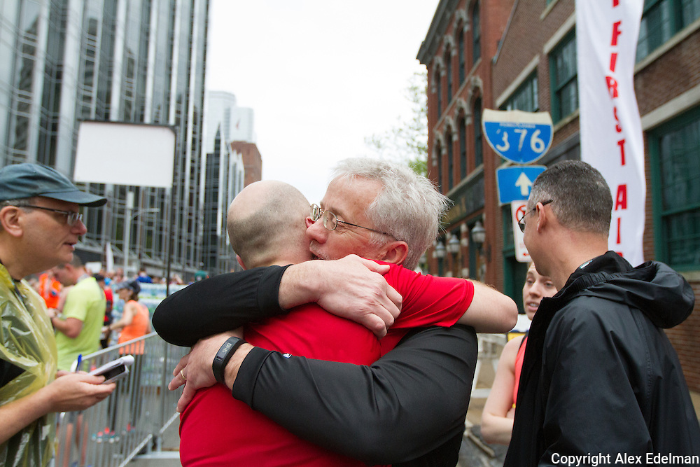 Jeff embraces his father following the 2016 race. His parents were across the country when he suffered his cardiac arrest the year before.