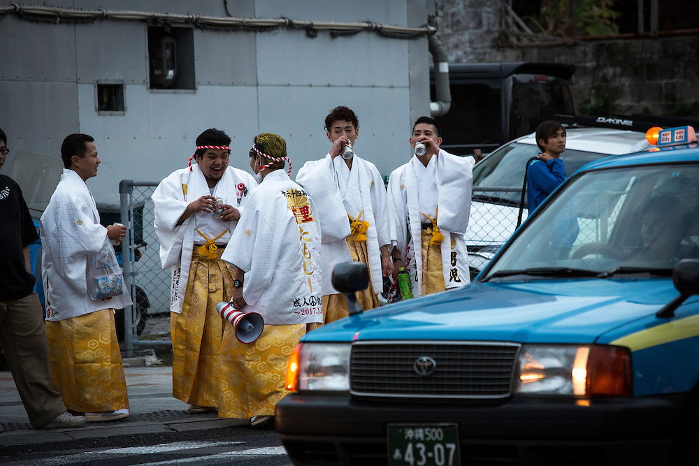 OKINAWA, JAPAN - JANUARY 8 : New adults drinking alchohol showing off in Kokusai dori after attending a Coming of Age Day celebration ceremony in Okinawa, Japan on January 8, 2017. The Coming of Age Day, one of the Japanese national holidays, is the day to celebrate young people who have reached the age of 20, the age of maturity in Japan, when they are legally permitted to smoke, drink alcohol and vote. (Photo by Richard Atrero de Guzman/NURPhoto)