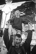 Father and Son, Ashton Court Festival, Bristol, UK, 1995.