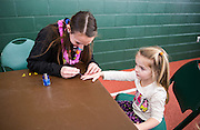 Claire Smeck gets her nails painted at the Fieldhouse Fest during Sibs Weekend.