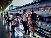 11 APRIL 2018 - BANGKOK, THAILAND:  People line the platform while they wait for a train at Hua Lamphong train station in Bangkok on the first day of the Songkran travel period. Songkran is the traditional Thai New Year and is one of the busiest travel periods of the year as Thais leave the capital and go back to their home provinces or resorts in tourist areas. Trains and busses are typically jammed the day before the three day Songkran holiday starts. The government has extended the official holiday period through Monday, 16 April because one day of the Songkran holiday fell on the weekend, giving many workers a five day holiday.      PHOTO BY JACK KURTZ
