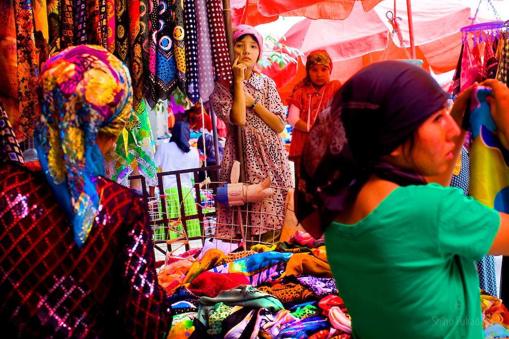 Uyghur women shop at market in Hotan, Xinjian province in China.