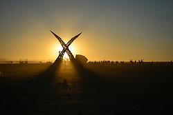 Apr 30, 2016 - Tankwa Town, Karoo Desert, South Africa - A giant sculpture of the letter ''X'', this year's theme at AfrikaBurn, stands out in front of a setting sun at this year's event in the Karoo Desert, South Africa, on April 30, 2016. AfrikaBurn, the smaller cousin of Burning Man, is now in its tenth year and aims to bring together creatives from all around the world to create art, exist in a non-monetary economy, and celebrate an alternative form of living. (Credit Image: © Tobin Jones/ZUMA Wire/ZUMAPRESS.com)
