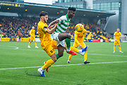 Vakoun Issouf Bayo (#10) of Celtic FC tries to control the ball in front of Ricki Lamie (#5) of Livingston FC during the Ladbrokes Scottish Premiership match between Livingston FC and Celtic FC at The Tony Macaroni Arena, Livingston, Scotland on 6 October 2019.