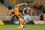 Wolverhampton Wanderers midfielder Kevin McDonald plays the ball tracked by Burnley midfielder Joey Barton during the Sky Bet Championship match between Wolverhampton Wanderers and Burnley at Molineux, Wolverhampton, England on 7 November 2015. Photo by Alan Franklin.