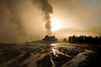Castle Geyser erupts at sunrise in Yellowstone National Park, Wyoming.