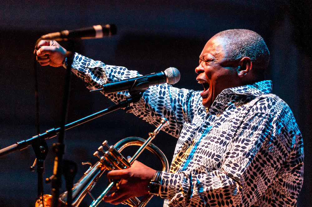Legendary jazz trumpeter Hugh Masekela performing at the Cheltenham Jazz Festival in England.
