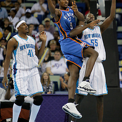 Oct 10, 2009; New Orleans, LA, USA;  Oklahoma City Thunder forward Serge Ibaka (9) passes as New Orleans Hornets forward Earl Barron (55) defends during the second quarter at the New Orleans Arena. Mandatory Credit: Derick E. Hingle-US PRESSWIRE