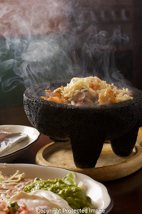 Rancho Allegro's Molecajete combo with chicken, shrimp, beef)--served in sizzling stone bowl.(Jodi Miller/Alive).