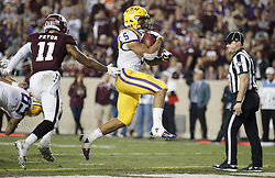 LSU running back Derrius Guice (5) skips into the end zone against Texas A&M defensive back Larry Pryor (11) during the third quarter of an NCAA college football game Thursday, Nov. 24, 2016, in College Station, Texas. (Sam Craft/The Eagle)