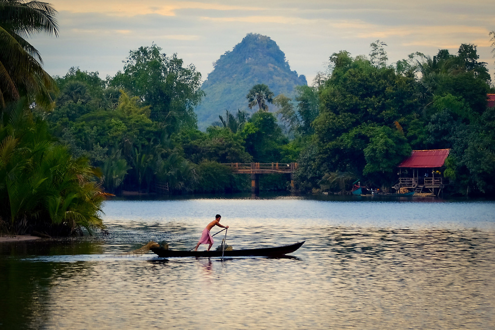 Fisherman on Kampot River. Cambodia. <br />