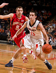 Virginia guard Sammy Zeglinski (13) dribbles past Maryland guard Eric Hayes (5).  The Virginia Cavaliers defeated the Maryland Terrapins 68-63 at the John Paul Jones Arena on the Grounds of the University of Virginia in Charlottesville, VA on March 7, 2009.