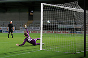 Accrington Stanley goalkeeper Toby Savin (40) dives the wrong way during the penalty shoot out  during the EFL Cup match between Burton Albion and Accrington Stanley at the Pirelli Stadium, Burton upon Trent, England on 5 September 2020.