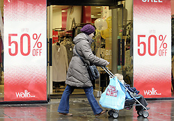 © Licensed to London News Pictures. 20/12/2012.Wet weather in the south East..Christmas shoppers in the wind and rain today (20.12.2012) in Bromley High Street,South East London..today.Photo credit : Grant Falvey/LNP