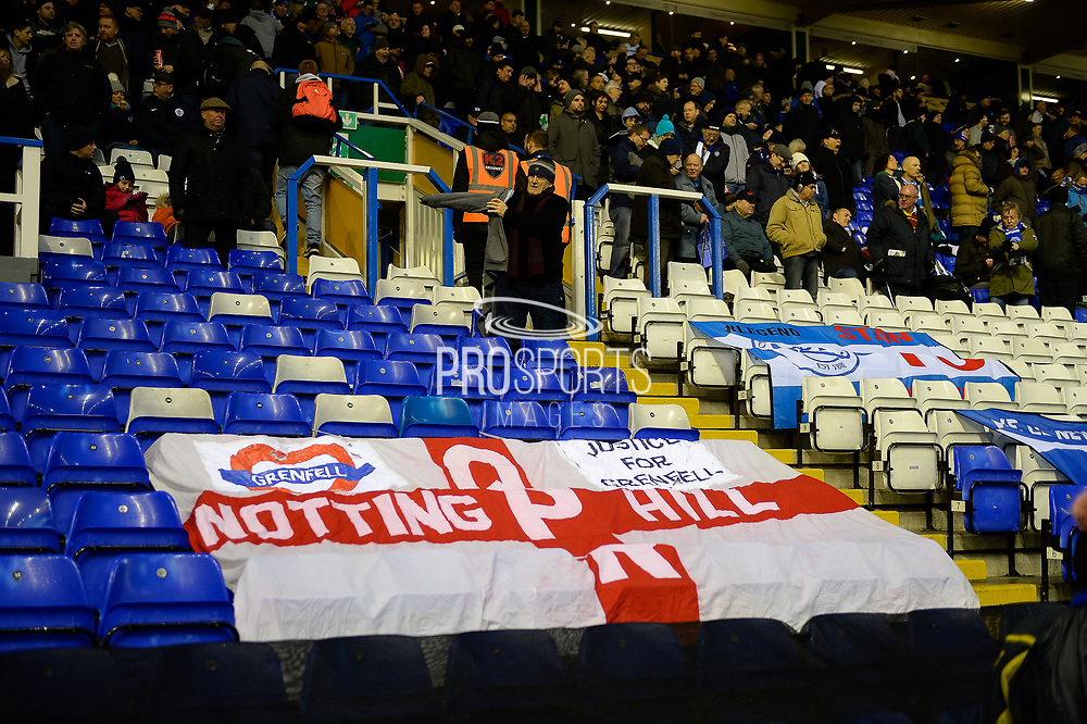 QPR supporters flag in support of  the Grenfell Tower disaster during the EFL Sky Bet Championship match between Birmingham City and Queens Park Rangers at St Andrews, Birmingham, England on 16 December 2017. Photo by Dennis Goodwin.