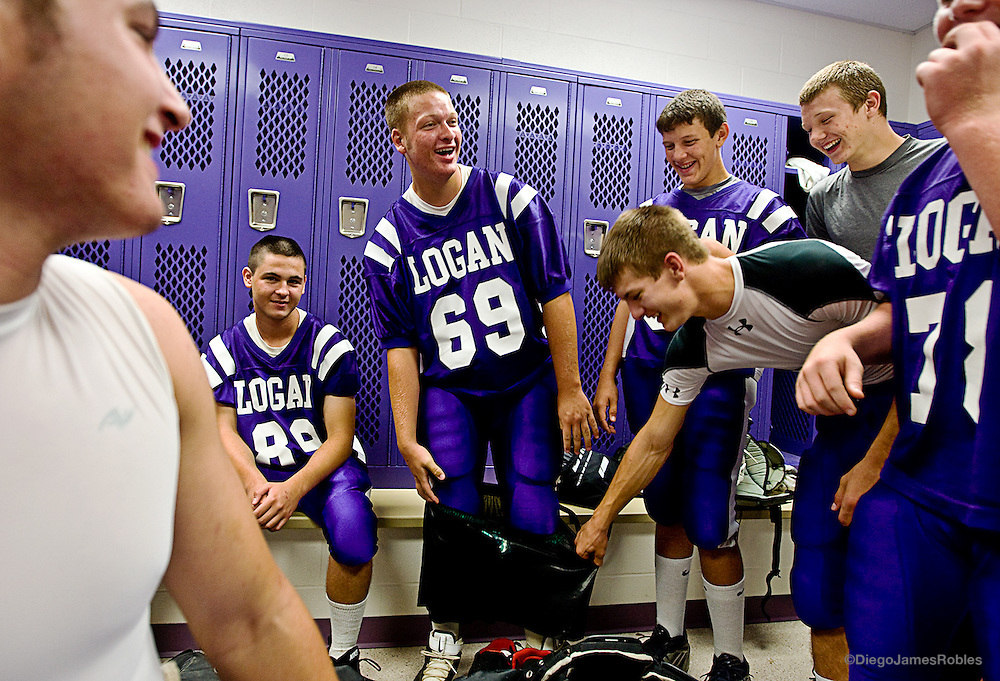 "Defensive tackle for Logan High School, John Teal is ""pantsed"" by teammates moments before their game."