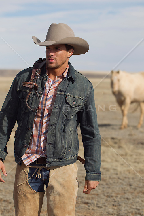 handsome cowboy walking on a ranch in New Mexico
