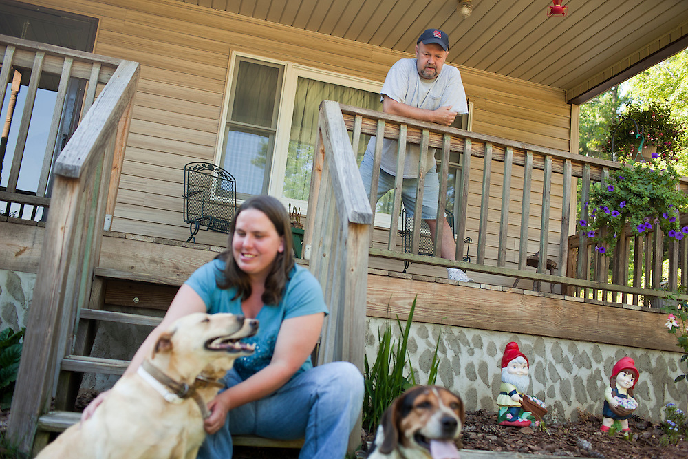 David Styles, 50, and his wife, Jennifer, outside their home near Marion, North Carolina, Sunday, June 20, 2010. Styles struggled to pay the mortgage on his home after the textile mill he worked at for nearly 30 years closed down. Thanks to the North Carolina Housing Finance Agency and its Home Protection Program, Styles now receives assistance to cover his mortgage and has up to 15 years to pay it back interest-free. ..State News NC: foreclosure.Wichita/Bellovin Bulletin.Model Released: Yes.