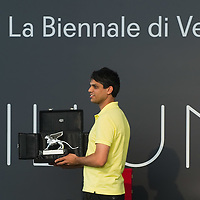 VENICE, ITALY - JUNE 04: Artist Haroon Mirza receives the Silver Lion for promising young artist at the ILLUMInations Exhibition during the  Official Awards  of the 54th International Art Exhibition on June 4, 2011 in Venice, Italy. This year's Biennale is the 54th edition and will run from June 4th until 27 November.