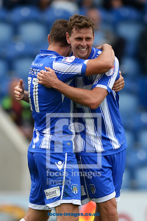 Chris Porter of Colchester United (right) celebrates scoring his sides second goal to make the scoreline 2-1 with Ben Dickenson of Colchester United during the Sky Bet League 2 match between Colchester United and Blackpool at the Weston Homes Community Stadium, Colchester<br /> Picture by Richard Blaxall/Focus Images Ltd +44 7853 364624<br /> 10/09/2016