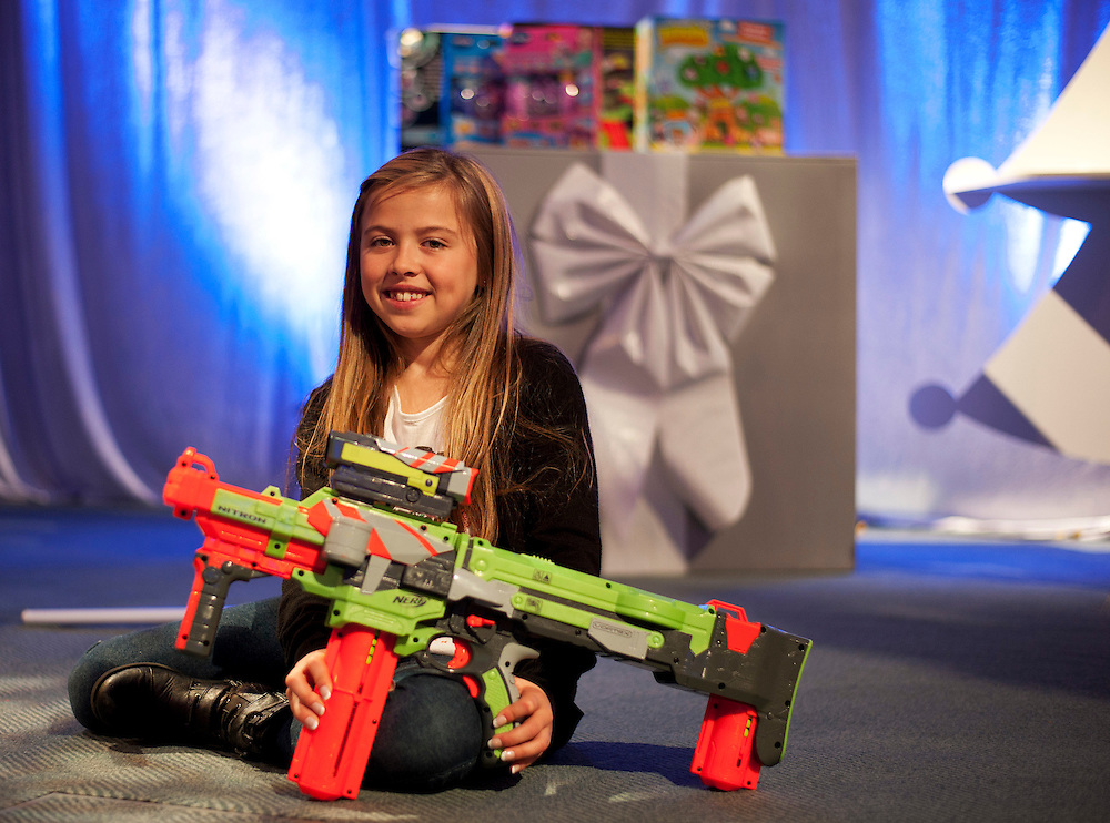 Olivia Chamberlain holds a Nerf Vortex Nitron Blaster priced at £44.99  on October 26th 2011 at the Dream Toys exhibition....