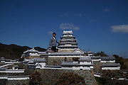 "VIDEO AVAILABLE - JAPAN OUT<br /> Huge miniature castle built by ONE MAN<br /> <br /> In Mie Precture, Japan, stands a 1/23 sized Miniature Himeji Castle. As many castle fans know the real Himeji Castle is known as a World Heritage Site and National Treasure. ""The Lord of the Castle"" as we call him, Hiroyasu Imura (78 years old), says he built a small replica of Himeji Castle when he was in 8th grade, and that memory stuck with him, leading him to make a bigger castle as an adult. He remembered his childhood dream when his wife gave him a book about Himeji Castle for his 47th birthday. Then, he started studying architecture at the library and visited the real Himeji Castle many times. In 1989, he finally started construction on his own Himeji Castle.<br /> <br /> As he studied, he learned how to use concrete, bolts, nuts, fiber reinforced plastics(FRP), and other materials necessary to build a high quality replica. Throughout the process he worked hard to realize the smallest of details so as to make it as close to the real thing as possible. Not only are the proportions completely accurate, but even the number of stairs are exactly the same as the real castle. He even went above and beyond to replicate the trees and moss around the castle, adding samurai and animal dolls as well, in order to create a life-like atmosphere. Mrs. Imura took a pottery lesson to make the dolls.<br /> <br /> He finished the castle in March, 2007. It cost him 18 million yen and took 19 years in all to build.<br /> <br /> This castle, built by the romanticism of one man, still amazes and enchants onlookers years after its creation.<br /> ©Exclusivepix Media"
