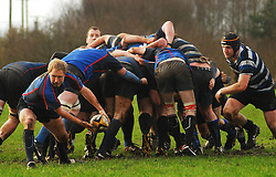 Westport's scrum half Tommy Ellard get the ball away with Corinthians Conor Hastings closing in...Pic Conor McKeown