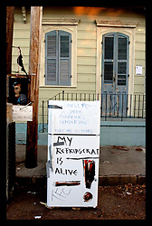 30th Oct, 2005. Hurricane Katrina aftermath, New Orleans, Louisiana. Refrigerator dumping. Locals in the Marigny neighbourhood add their stinking appliances to others already lining the street.