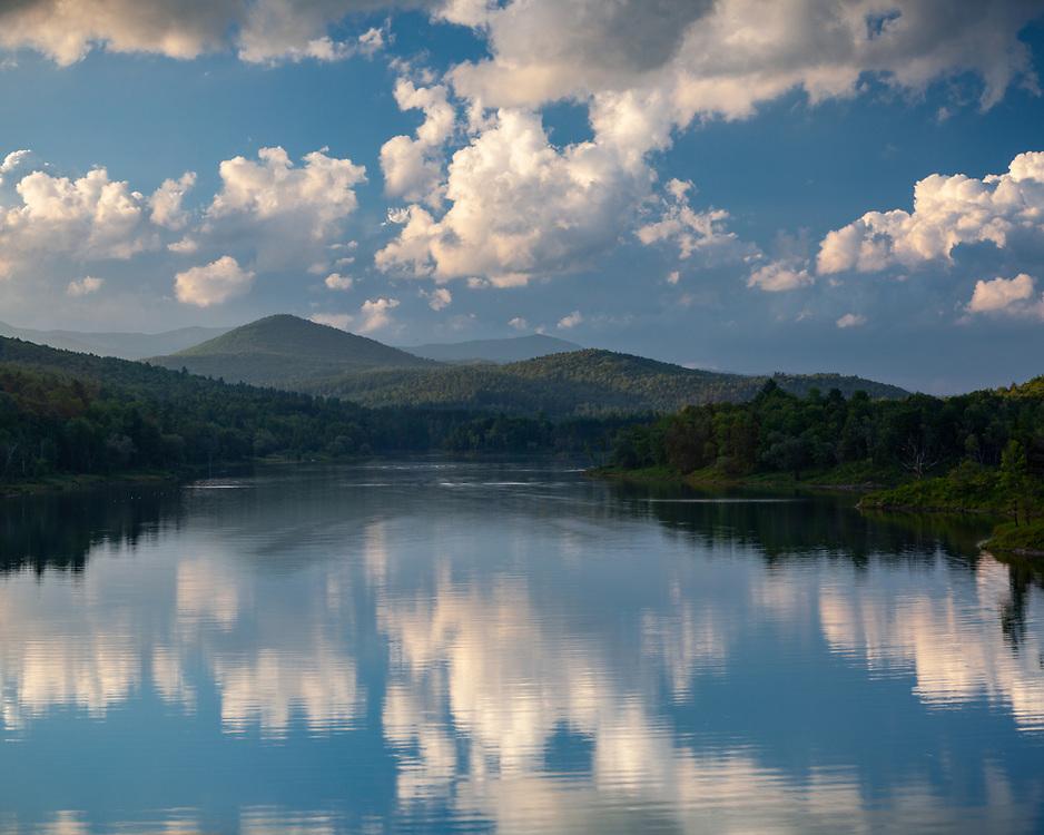 Summer evening cumulous clouds over Wrightsville Reservoir, Middlesex, Vermont