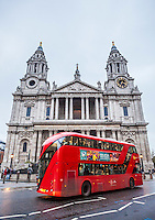 St Paul's Cathedral with double decker bus driving past. London, UK.