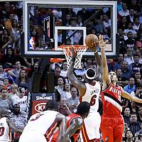 08 March 2011: Miami Heat small forward LeBron James (6) takes a jumpshot over Portland Trail Blazers small forward Nicolas Batum (88) during the Portland Trail Blazers 105-96 victory over the Miami Heat at the AmericanAirlines Arena, Miami, Florida, USA.