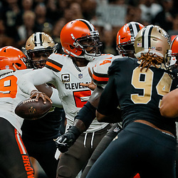 Sep 16, 2018; New Orleans, LA, USA; Cleveland Browns quarterback Tyrod Taylor (5) passes under pressure from New Orleans Saints defensive end Cameron Jordan (94) during the fourth quarter of a game at the Mercedes-Benz Superdome. The Saints defeated the Browns 21-18. Mandatory Credit: Derick E. Hingle-USA TODAY Sports